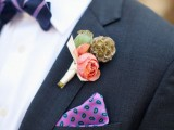 a quirky wedding boutonniere with a pink bloom, greenery and a sphere is a refined idea for a stylish fall groom