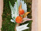 a bright fall wedding boutonniere with orange blooms, white and pink branches and a pale leaf is a catchy and cool idea