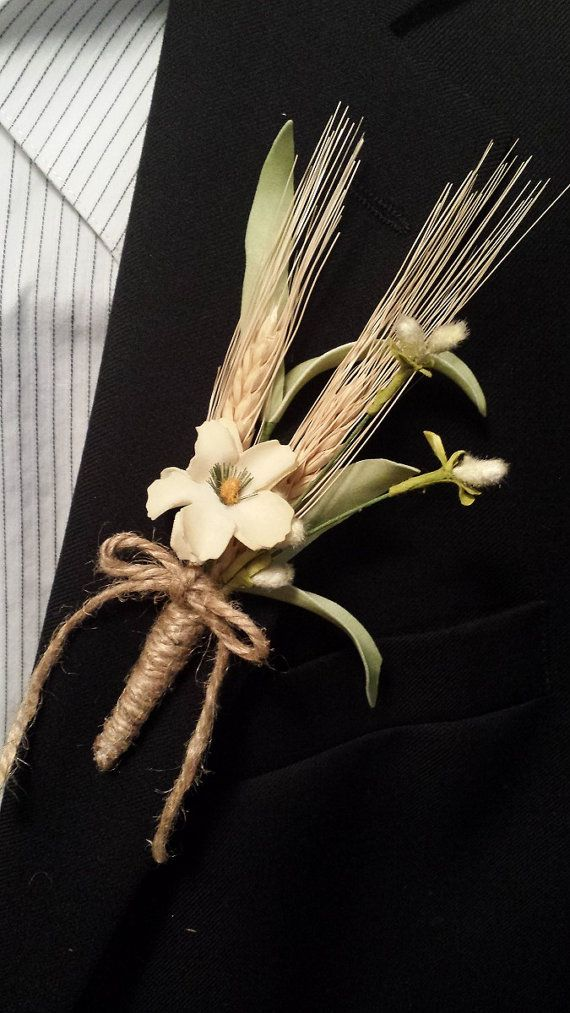 a rustic fall wedding boutonniere with spikes, a bloom, some fluffs and a twine bow is a stylish and cool idea