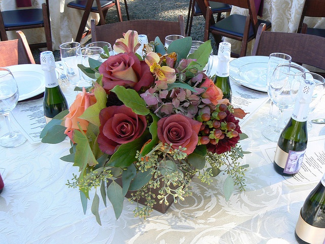 a simple and elegant fall flower centerpiece of dark roses, bright blooms and eucalyptus is timeless