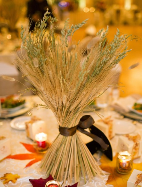 a wheat fall wedding centerpiece is a cool solution for a fall wedding that won't wither