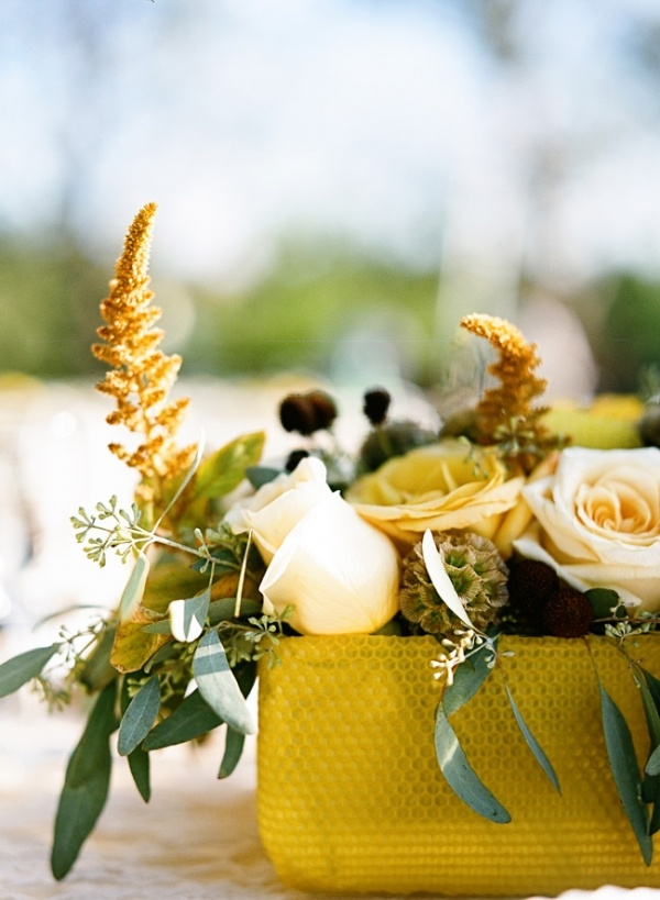 a gold box with neutral blooms, greenery and some dried touches is a chic decadent fall wedding centerpiece