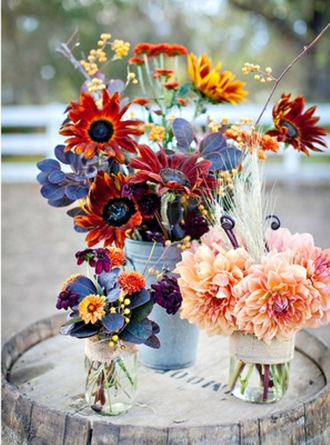 colorful floral fall wedding centerpieces of bright blooms, dark foliage and flowers are easy to DIY for your fall wedding