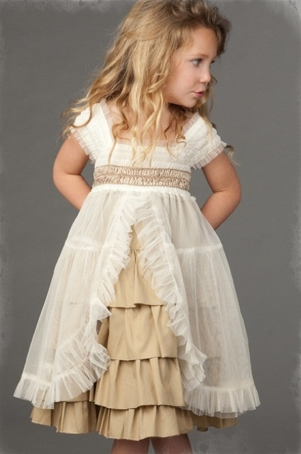 a tan underdress, a white tulle overdress with ruffles and pleats for an unusual and boho look