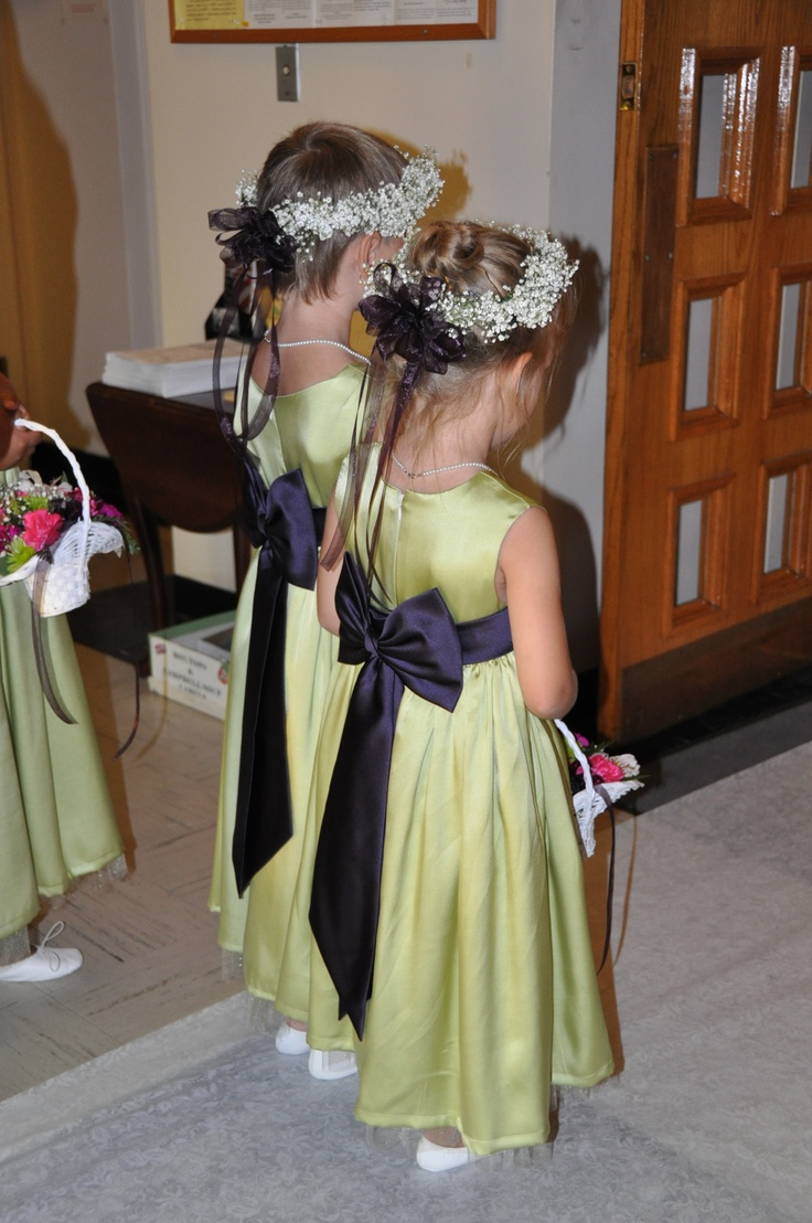 green A line flower girl dress with black sashes and bows are a cute touch of color and look classic