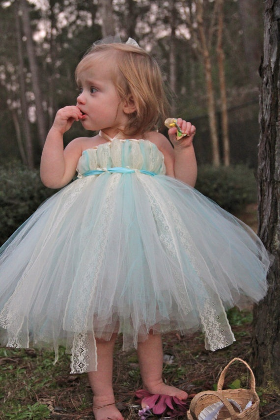 a blue and white tulle strapless flower girl dress for a very little bridesmaid