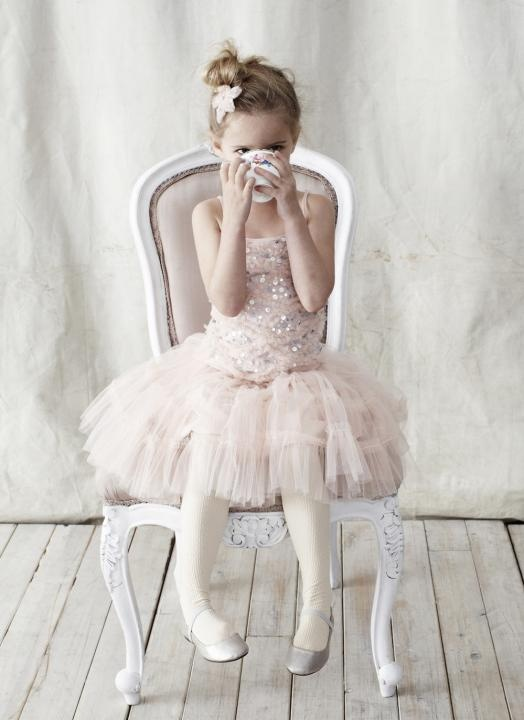 a blush dress with an embellished bodice and a tulle skirt plus spaghetti straps is a beautiful ballerina style outfit