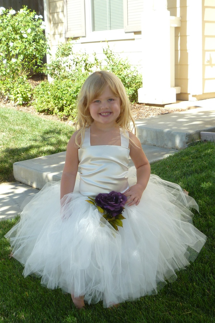 a neutral flower girl dress with a silky bodice, straps and a tulle skirt is a lovely idea with a cute touch
