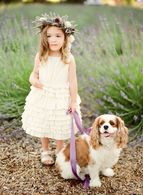 a neutral sleeveless flower girl dress with a sleek bodice and a ruffle skirt is a stylish idea for a spring or summer flower girl