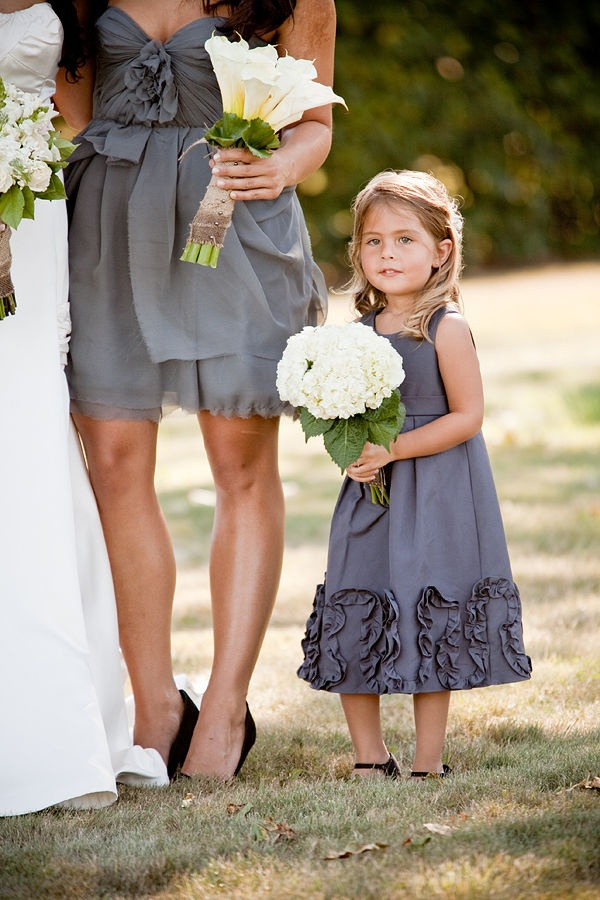 a grey A line sleeveless flower girl dress with floral detailing is a stylish idea for a modern wedding