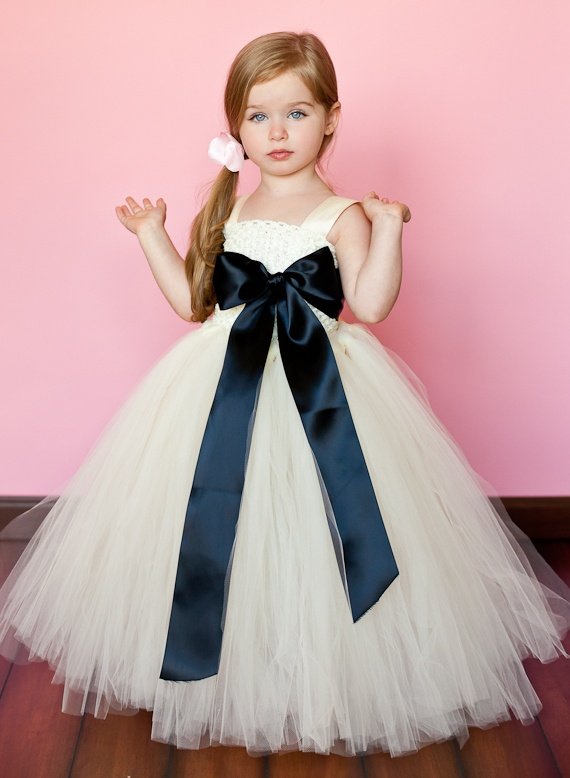 a tulle A line flower girl dress with a black silk bow is a beautiful and pretty girlish idea to rock