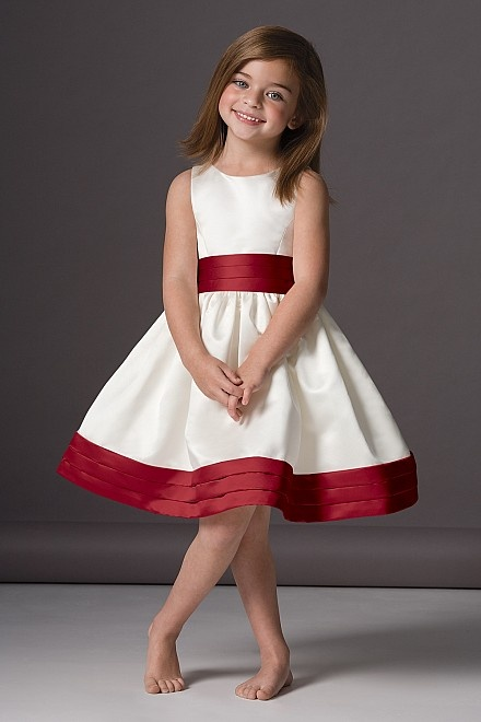 a white A line flower girl dress with a burgundy sash and a burgundy trim on the edge for a classic and rather formal look