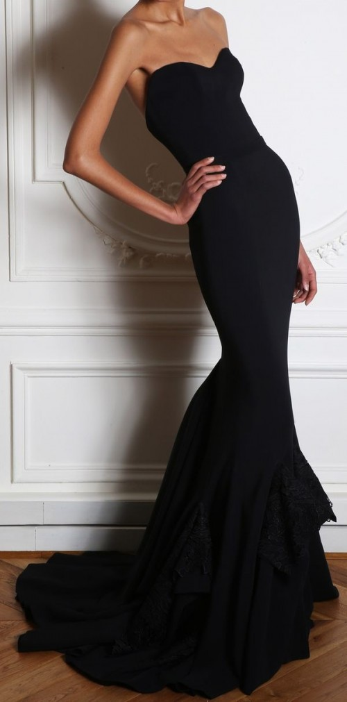 a sexy strapless mermaid maxi dress with a train and lace touches on the skirt is fantastic and statement-like