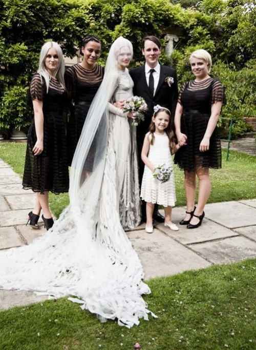 catchy black stripe midi and knee bridesmaid dresses with an illusion neckline, short sleeves, sashes and black shoes for a Halloween wedding