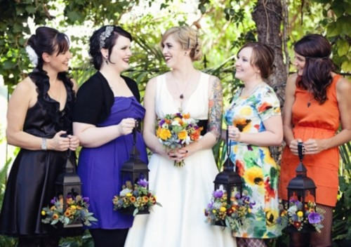 mismatching black, purple, orange and floral bridesmaid dresses to show each girl's style and favorite color