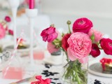 a modern bright Valentine's Day wedding tablescape done in black, white and fuchsia and light pink plus touches of gold