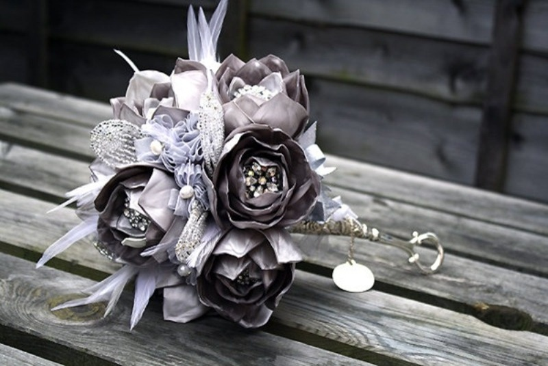 a grey and lavender wedding bouquet with rhinestones and beads is a unique idea that may match your color scheme or not