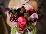 a colorful and sumptuous wedding bouquet in purple, pink and red plus greenery will add colro to your wedding look
