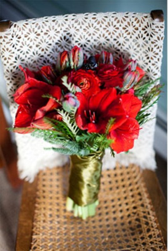 a bold red and greenery wedding bouquet with a gold wrap is amazing for a holiday wedding