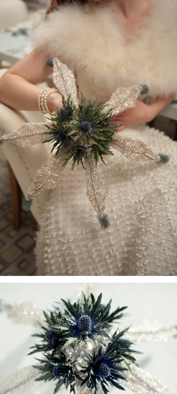 a bold winter wedding bouquet of thistles and shiny glitter snowflake elements is a unique idea