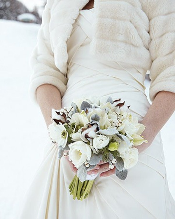 a white and pale winter wedding bouquet with blooms, cotton and foliage