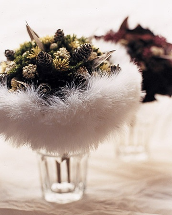 a winter wedding bouquet of pinecones, dried blooms, feathers feels cozy and very cute