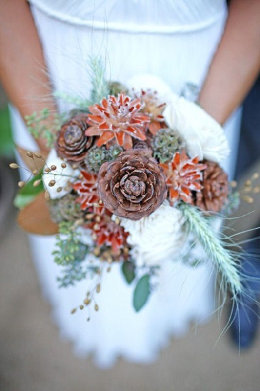 a dried winter wedding bouquet of pinecones, blooms, dried foliage and herbs will also do for a fall wedding