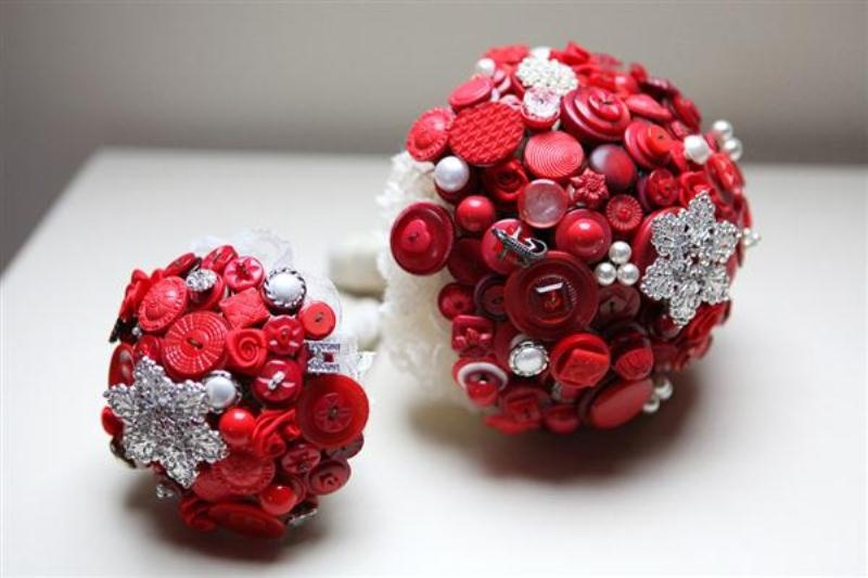 ball wedding bouquets made of red and silver buttons look very bold and very unusual