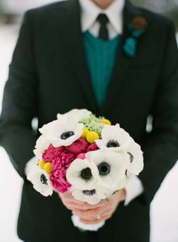 a bold winter wedding bouquet with white and pink blooms plus billy balls will add a colorful accent