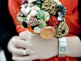 a non-typical wedding bouquet of buttons and brooches and glitter yarn balls is a very creative idea