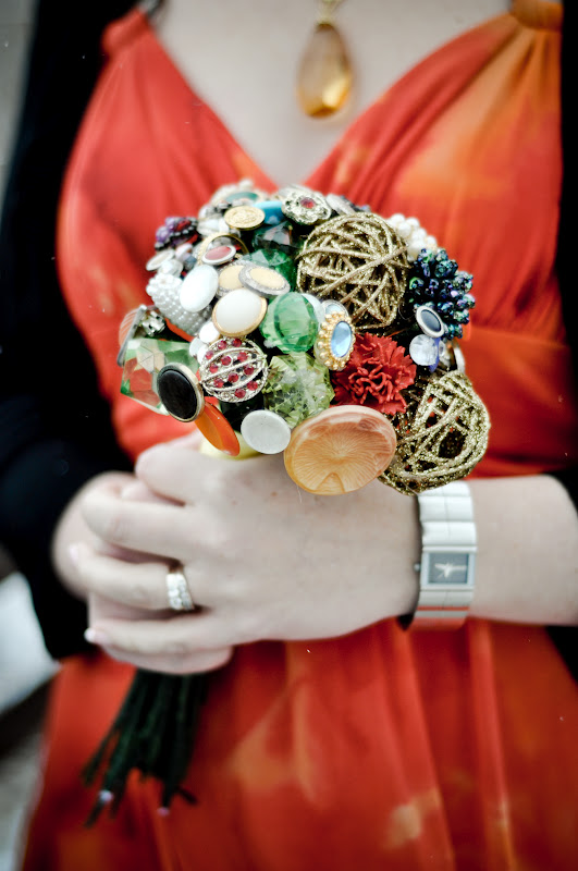 a non typical wedding bouquet of buttons and brooches and glitter yarn balls is a very creative idea
