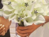 a white calla wedding bouquet with beaded flowers is classics and chic, it will give a refined touch to your look