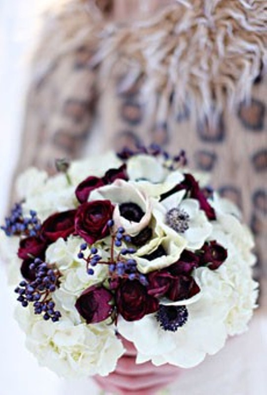 a bright winter wedding bouquet with white and deep red blooms plus berries will be a nice idea for winter