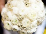 an all-white winter wedding bouquet of two types of blooms is amazing for a winter wedding