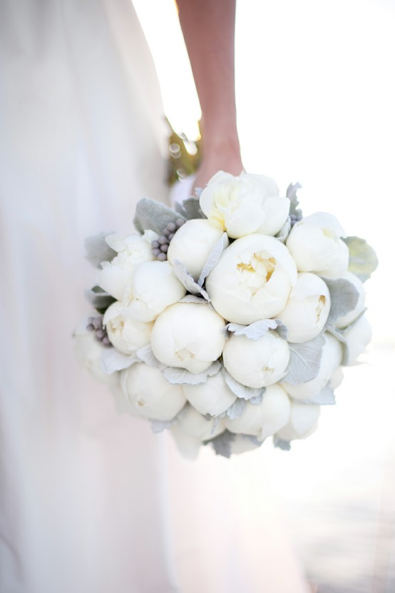 a chic white winter wedding bouquet with pale greenery with grey berries is a gorgeous idea