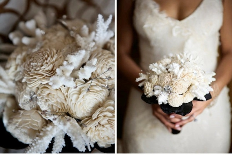a creative winter wedding bouquet of fabric blooms and white corals looks as if it's frozen