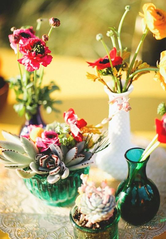 bright florals and succulents in vases will make yoru summer boho wedding cheerful