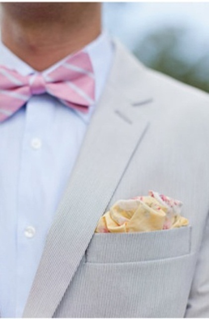 a neutral suit, a pink striped bow tie and a peachy handkerchief for a light and cheerful spring or summer groom's outfit
