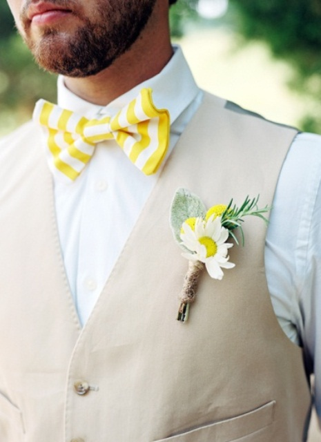 a bright summer groom's look with a white shirt, a tan waistcoat, a yellow and white striped bow tie and a bright boutonniere