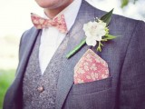 a coral botanical print bow tie and handkerchief and a fresh white bloom accent the outfit in a chic and cool way