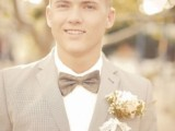 a sandy groom's suit, a white shirt and a brown bow tie plus a floral boutonniere for an elegant summer outfit