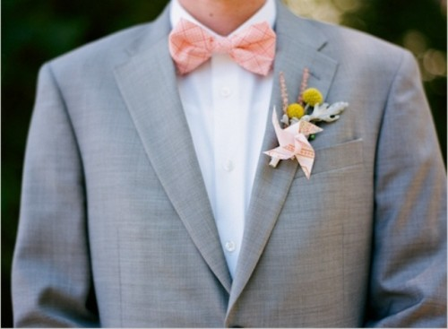 a dove grey suit, a white shirt, a printed peachy bow tie and a billy ball boutonniere for a spring or summer look