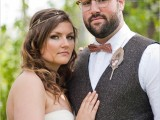 a printed rust-colored bow tie perfectly matches the boho look of the groom with a white shirt, a tweed waistcoat and a feather boutonniere