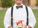 a monochromatic look with a black striped bow tie, thick suspenders and black pants for a summer or spring wedding