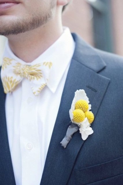 a grey suit, a white shirt, a white and yellow printed bow tie and a billy ball boutonniere to rock in spring or summer