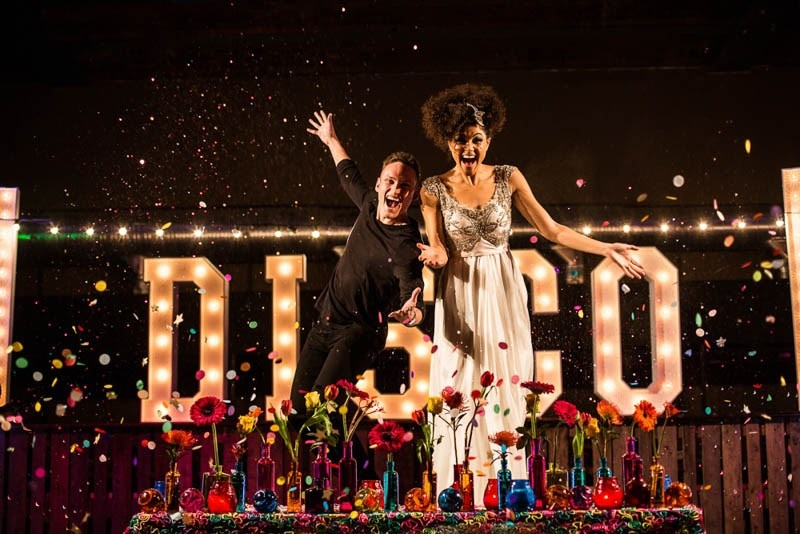 Picture Of bright and fun 70s disco inspired wedding with an industrial feel  1