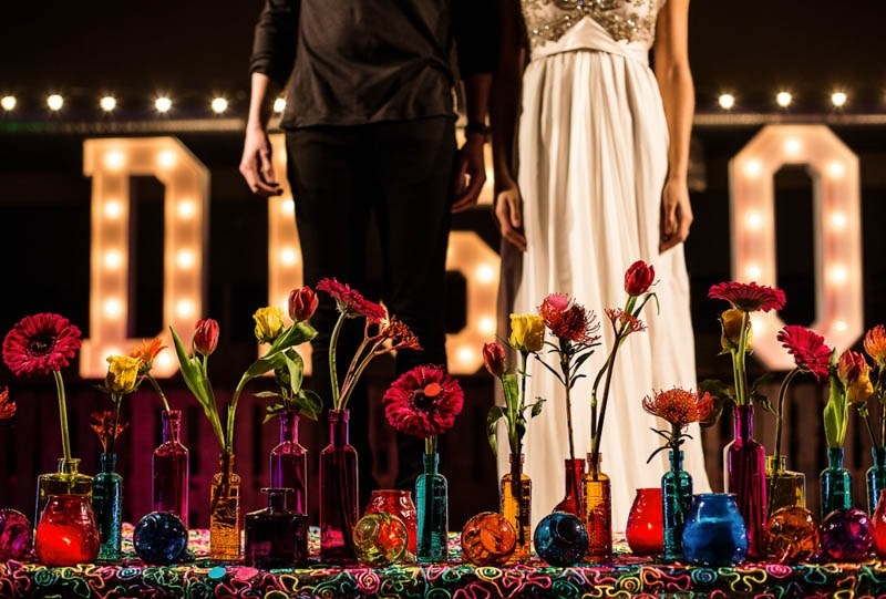 Picture Of bright and fun 70s disco inspired wedding with an industrial feel  10