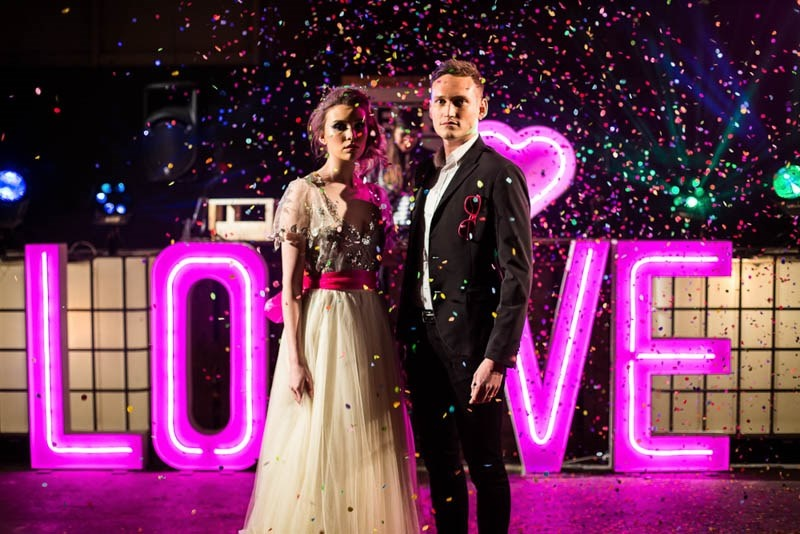 Picture Of bright and fun 70s disco inspired wedding with an industrial feel  12