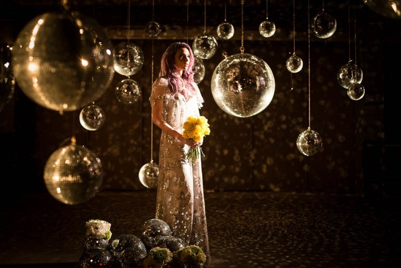Picture Of bright and fun 70s disco inspired wedding with an industrial feel  4