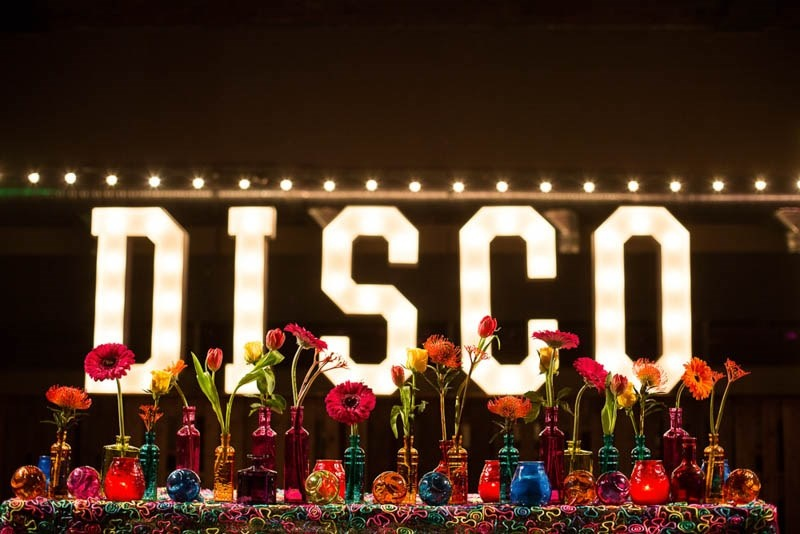 Picture Of bright and fun 70s disco inspired wedding with an industrial feel  7